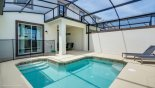 Townhouse rentals near Disney direct with owner, check out the View from pool deck towards villa showing lanai & rear patio doors with child guard