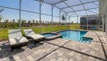Two luxury sun loungers at top of pool deck from Champions Gate rental Villa direct from owner