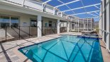 Toddler safety guard separating lanai area and pool deck with this Orlando Villa for rent direct from owner