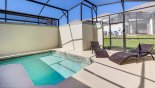 Covered private pool with 2 comfortable sun loungers with this Orlando Townhouse for rent direct from owner
