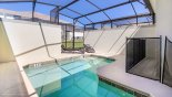 L shaped west facing plunge pool with toddler safety guard from Beach Palm 7 Townhouse for rent in Orlando