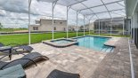Spacious rental Champions Gate Villa in Orlando complete with stunning Large heated pool with 3 comfortable sun loungers and 2 tables