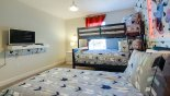 Spacious rental Champions Gate Townhouse in Orlando complete with stunning Disney themed bedroom 2 with single bedside & lamp