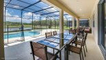 40' covered lanai with 2 patio tables & 12 chairs - www.iwantavilla.com is the best in Orlando vacation Villa rentals