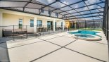 Orlando Villa for rent direct from owner, check out the View of pool deck towards covered lanai showing additional 2 sun loungers