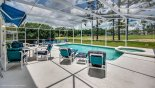Pool deck with 6 sun loungers and privacy hedging to both sides from Highlands Reserve rental Villa direct from owner