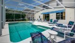 View of pool towards villa showing 2 patio tables & 6 chairs with this Orlando Villa for rent direct from owner