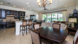 Villa rentals near Disney direct with owner, check out the View of kitchen from breakfast nook showing breakfast bar with 4 bar stools