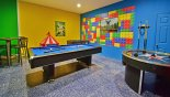 Villa rentals in Orlando, check out the LEGO themed games room with pool table, air hockey, table foosball & arcade game