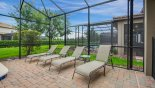Spacious rental Champions Gate Villa in Orlando complete with stunning Pool deck with 4 sun loungers