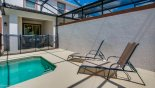 View of sun loungers and covered lanai from Beach Palm 9 Villa for rent in Orlando
