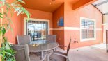Villa rentals near Disney direct with owner, check out the Covered lanai with patio table & 4 chairs & ceiling fan