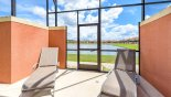 Spacious rental Paradise Palms Resort Villa in Orlando complete with stunning Pool area with 2 sun loungers and views to pond