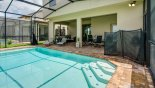 Spacious rental Windsor at Westside Villa in Orlando complete with stunning View of pool towards covered lanai showing pool safety fence partially erected