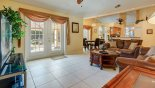 The family room opening out onto the pool deck from Orange Tree rental Villa direct from owner