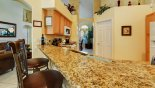The kitchen, the heart of the house, with all granite work surfaces - www.iwantavilla.com is the best in Orlando vacation Villa rentals