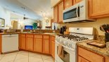 Spacious rental Orange Tree Villa in Orlando complete with stunning Samsung gas range and microwave as well as a Bosch dish washer