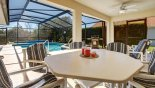 Al fresco dining on the pool deck - www.iwantavilla.com is your first choice of Villa rentals in Orlando direct with owner