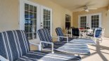 Villa rentals near Disney direct with owner, check out the Plenty of seating for everyone under the extended lanai