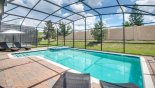 Villa rentals in Orlando, check out the Covered pool area wit 4 comfortable sun loungers