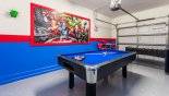 Games room with a pool table and foosball table for you to enjoy with this Orlando Villa for rent direct from owner
