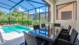 Pool side seating for 6 people under shady lanai from Alexander Palm 1 Villa for rent in Orlando