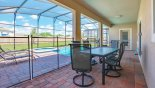 Spacious rental Champions Gate Villa in Orlando complete with stunning Seating for 6 people under shady lanai
