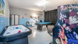 Incredible games room located in the garage with an air hockey and pool table with this Orlando Villa for rent direct from owner