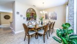 Eagle Bay 2 Villa rental near Disney with Dining table with 8 comfortable chairs - arched opening to kitchen