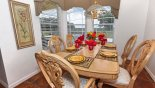 Dining room seating for 6 with views over pool deck - www.iwantavilla.com is your first choice of Villa rentals in Orlando direct with owner
