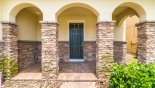 Villa entrance with 3 stone pillared feature arches from Tahiti 2 Villa for rent in Orlando