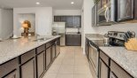 Fully fitted kitchen with quality appliances and granite counter tops from Tahiti 2 Villa for rent in Orlando
