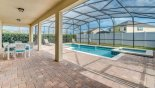 Pool deck is fully screened for privacy by hedges & fence with this Orlando Villa for rent direct from owner