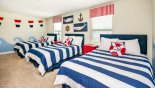 Nautical themed Bedroom 9  with 3 full size beds & 2 nightstands from Champions Gate rental Villa direct from owner