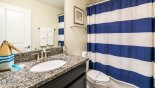 Family Bathroom 3 with single sink, WC & shower over bath with this Orlando Villa for rent direct from owner