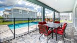Villa rentals in Orlando, check out the Shady lanai with patio table with seating for 6 people