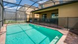 Spacious rental Windsor at Westside Villa in Orlando complete with stunning View of pool towards covered lanai - note pool safety fence erected