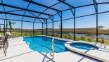 View of pool deck to open views and pond from Solterra Resort rental Villa direct from owner