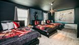 Villa rentals in Orlando, check out the Bedroom #9 with Star Wars theming ad 3 x full-size beds