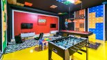 Orlando Villa for rent direct from owner, check out the Games room with 2 wall mounted LCD cable TV's with PS4 games consoles & gaming chairs