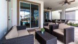 Spacious rental Solara Resort Villa in Orlando complete with stunning Covered lanai with rattan sofa and 2 arm chairs