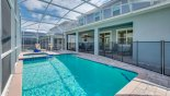 Spacious rental Champions Gate Villa in Orlando complete with stunning Pool deck with toddler pool safety fence erected