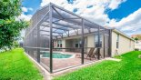 Villa rentals near Disney direct with owner, check out the View of pool cage from rear gardens
