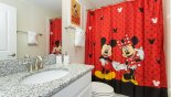 Villa rentals near Disney direct with owner, check out the Family bathroom #3 with Mickey & Minnie theming - bath with shower over