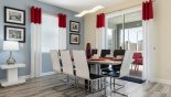 Dining area seating 8 with views onto pool deck from Majesty Palm 10 Villa for rent in Orlando