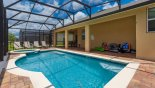 Spacious rental The Dales at West Haven Villa in Orlando complete with stunning Pool viewed towards covered lanai with patio table & 6 chairs