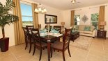 Living room and dining area with this Orlando Villa for rent direct from owner