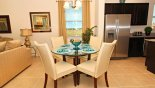 Breakfast nook with round glass topped table & 4 chairs from The Dales at West Haven rental Villa direct from owner