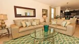 Family room with comfortable leather sofas with this Orlando Villa for rent direct from owner