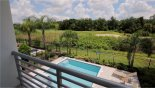 Villa rentals in Orlando, check out the View of pool and views beyond from master #1 balcony